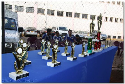 Trophies to be presented to the volleyball players.