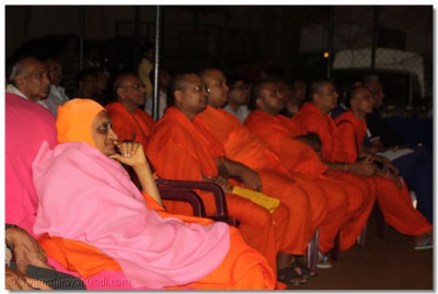 Acharya Swamishree and Sant mandal watching the volleyball tournament.