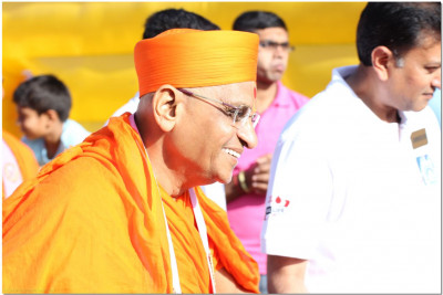 Acharya Swamishree proceeds to the playground area