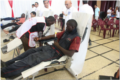 A security guard donating blood