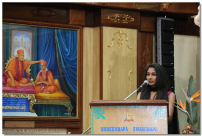 A devotee narrating a short story of Shree Gopalanand Swami