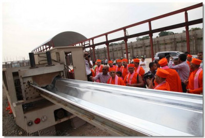 Acharya Swamishree takes a look at different machineries.