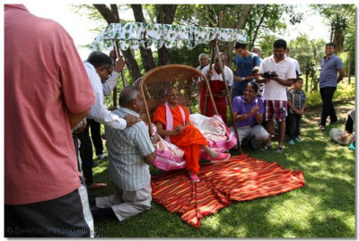 Acharya Swamishree and disciples have fun at the lodge