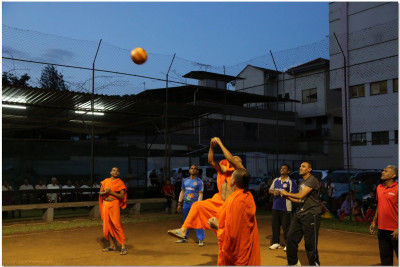 Sants and devotees enjoy playing volleyball