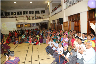 Various devotees gather at H.H Swamibapa Hall for the prize giving and New Year's Eve