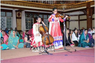 A violin performance by young devotees