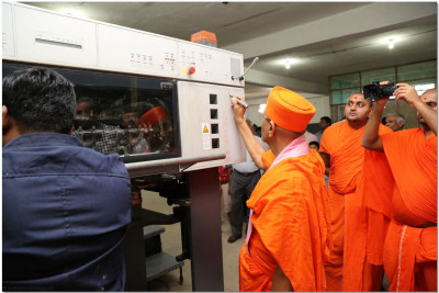 Poojan to new machinery at printing press
