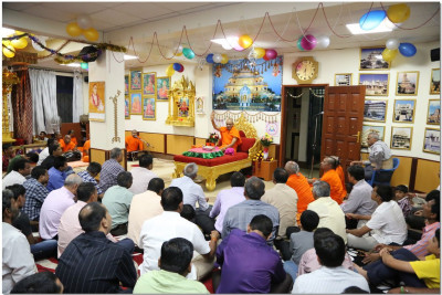 Devotees keenly listen to divine blessings