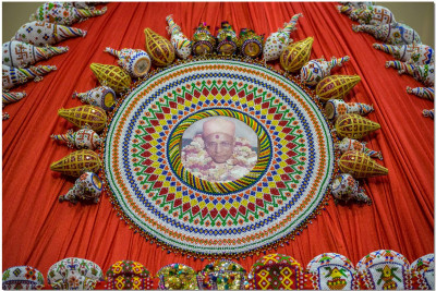 Beautifully bead handcrafted coconuts with a murti of Jeevanpran Swamibapa