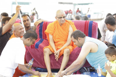 Devotees perform panchamrut
