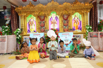 Young devotees pose for a photo