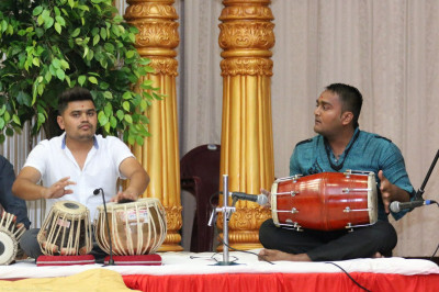 Devotees sing devotional songs along with the musical instruments