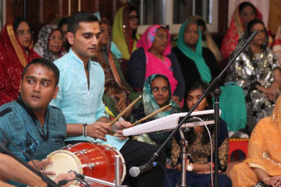 Devotees play instruments along with the devotional songs