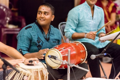 Devotees melodiously play various musical instruments along with devotional songs