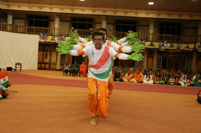 Devotees perform a patriotic dance on the auspicious day