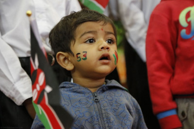 A young patriotic devotee holding the Kenyan flag