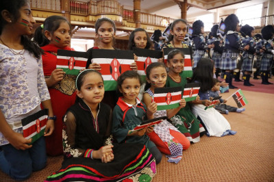 Young patriotic devotees proudly holding the Kenyan flag