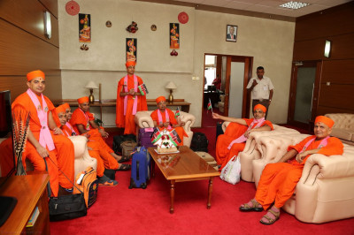 Acharya Swamishree and Sant Mandal at the JKIA VIP lounge