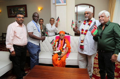 Acharya Swamishree blesses the former Mayor Ahmed Abubakar and devotees at Moi International Airport, Mombasa