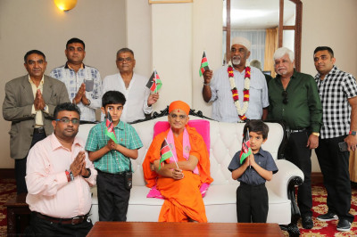 Acharya Swamishree blesses devotees at Moi International Airport, Mombasa