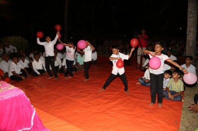 Young devotees perform a birthday dance