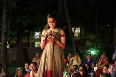 A young devotee recites a story of Acharya Swamishree