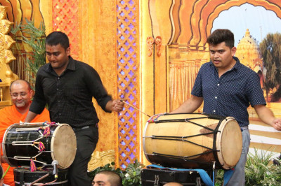 Musicians play dhol as devotees play raas