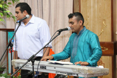 Musicians sing as devotees play raas