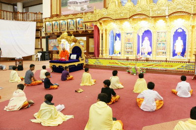 Young devotees sitting in their positions to commence the pooja