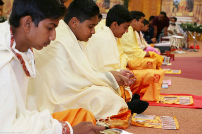 Young devotees perform pooja