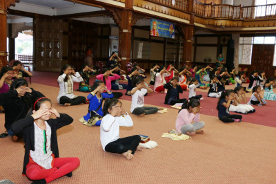 Devotees perform pranayams during the yoga session