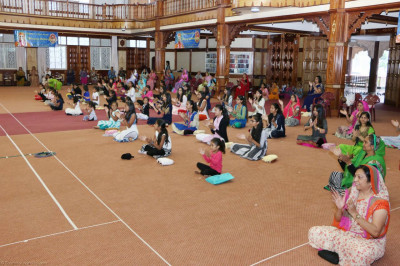 Devotees perform clapping yoga