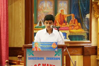 A young devotee recites a section from the Vachnamrut