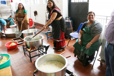Devotees help in the kitchen for lunch