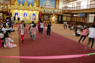 Devotees take part in the indoor games