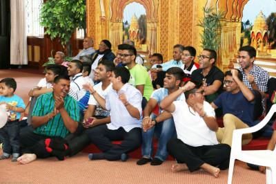 Devotees enjoying watching the indoor games