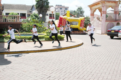 One of the teams running to the finish point to complete their final task