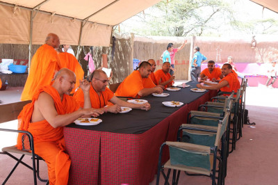 Sant mandal have their lunch at the luxury tented lodge