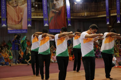 A patriotic dance performed by devotees to welcome the Kenya Society of the deaf on India's republic day