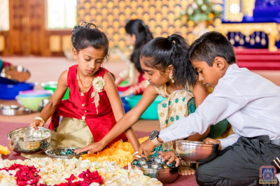 Young devotees joyfully assist in the decorations
