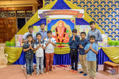Young devotees who took part in the event pose for a photo