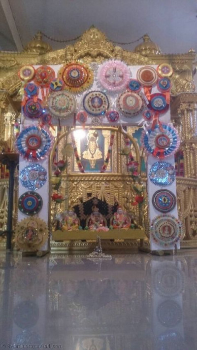Lord Shree Swaminarayanbapa Swamibapa giving Divine darshan on a hindolo made of badges