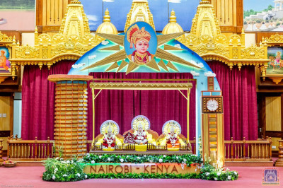 Divine darshan of Lord Shree Swaminarayanbapa Swamibapa on a hindolo made of miniatures of Nairobi's iconic buildings