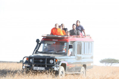 Sants and devotees go for a game drive