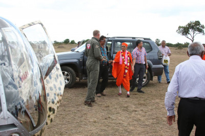 Acharya Swamishree going to consecrate the helicopter