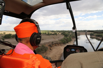 Acharya Swamishree consecrates the helicopter