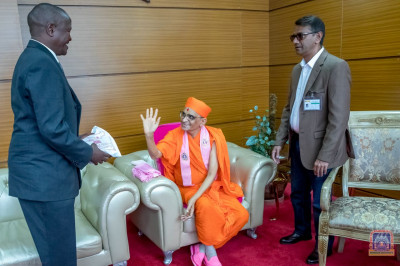 Acharya Swamishree blesses Mr. John Muchugu the manager for Airport Security Services