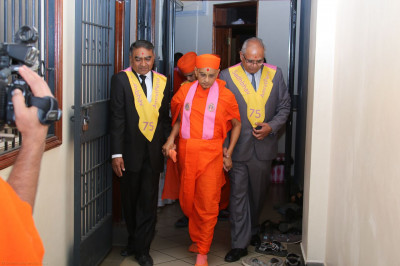 Acharya Swamishree being escorted to the kitchen for consecration of food