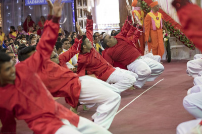 Devotees perform a dance to please Lord Swaminarayabapa Swamibapa