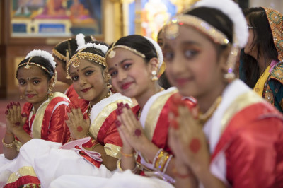Young devotees pose for a photo after a dance performance